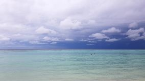 Gorgeous colorful tropical landscape. Maldives, Indian Ocean.White sand beach. Turquoise water, blue sky with snow white clouds. Green trees. Time lapse stock video footage
