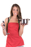 Gorgeous cooking woman in apron Stock Photography
