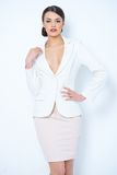 Gorgeous Corporate Woman Showing Cleavage. Close up Gorgeous Young Woman Wearing White and Light Pink Corporate Attire   Showing her Cleavage While Posing in Stock Image