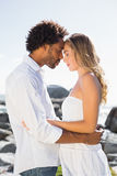 Gorgeous couple embracing by the coast Royalty Free Stock Image