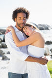 Gorgeous couple embracing at the coast Royalty Free Stock Images