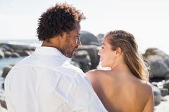 Gorgeous couple embracing by the coast Royalty Free Stock Photos
