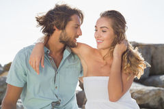 Gorgeous couple embracing at the coast Royalty Free Stock Photos
