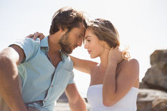 Gorgeous couple embracing at the coast Royalty Free Stock Photo