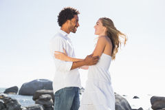 Gorgeous couple embracing at the coast Stock Photography