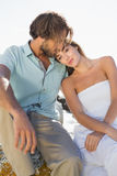 Gorgeous couple embracing at the coast Stock Photo