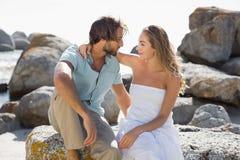 Gorgeous couple embracing at the coast Stock Photos