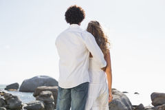 Gorgeous couple looking out to sea Stock Images