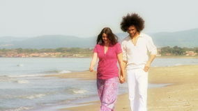 Gorgeous couple walking on the beach dream look Stock Image
