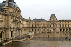 Gorgeous courtyard full of sightseers admiring The Louvre,Paris,2016 Stock Photo