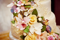 Gorgeous cream wedding cake with roses in 2 tiers  flowers from mastic. Gorgeous cream wedding cake with cream roses in 2 tiers with flowers from mastic Stock Images