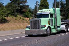 Gorgeous custom build big rig semi truck painted in light mint g Stock Photo