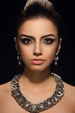 Gorgeous, cute woman with beautiful necklace Stock Photos