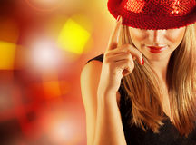 Gorgeous dancer female. Photo of gorgeous dancer female with finger up on the stage in disco club, closeup portrait of pretty blond woman isolated on shining royalty free stock photos