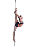 Gorgeous dancer performs gymnastic split on pole Royalty Free Stock Images
