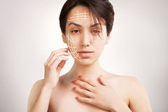 Gorgeous  dark haired model portrait with skin surgery mark isol Stock Photography