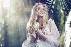 Gorgeous delicate woman with the sun beams in the background Royalty Free Stock Images