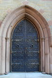Gorgeous detail in arched stone and brass doorway Royalty Free Stock Photo