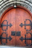 Gorgeous detail in heavy wood doors with elaborate black,metal hardware Stock Photos