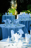 Gorgeous Dinner Setting. Round tables elegantly set for a wedding reception in the open air Stock Photos