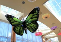 Beautiful hanging butterflies and umbrellas fill corridors with color, Turning Stone Casino, New York, 2016 Stock Photo