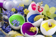 Gorgeous Easter decoration with egg shells and paints. On a blue pad royalty free stock images