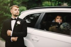 Close-up portrait of a pretty bride in a car window royalty free stock photo