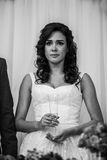 Gorgeous emotional brunette bride tearing up during a toast at w Stock Photos