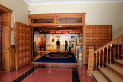 Gorgeous entrance with people studying exhibits,New York State Military Museum and Veterans Research Center,Saratoga,2015 Royalty Free Stock Photo