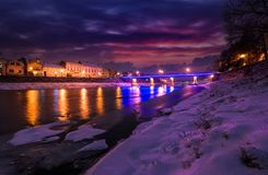 Gorgeous evening cityscape of old town in winter. Gorgeous evening cityscape of old european town Uzhgorod in winter. beautiful cloudy sky over the river Uzh Stock Photography