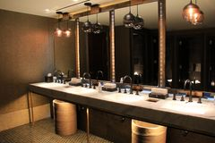 Contemporary image of ultra-modern bathroom in hotel, Baltimore,Maryland, 2017. Gorgeous example of contemporary bathroom, with sleek fixtures and beautiful royalty free stock photo