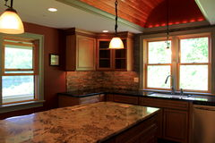 Free Gorgeous Examples Of Marble Countertops And Lighting In Construction Of Modern Kitchen Stock Image - 64862041