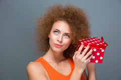 Gorgeous excited curious female dreaming about surprise holding box Stock Photo