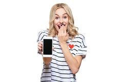 Gorgeous excited woman showing blank screen mobile phone over white background, celebrating victory and success. Excitement. stock photos