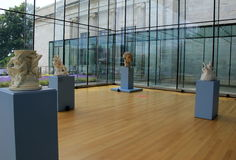 Gorgeous exhibit of tall blue stands with sculptures,Cleveland Art Museum,Ohio,2016 Stock Photos