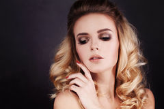Gorgeous Fashion Model with Makeup and Blonde Curly Stock Photo