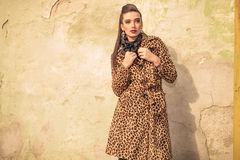 Gorgeous fashion woman fixing her coat Stock Images