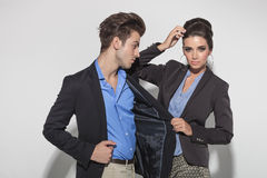 Gorgeous fashion woman pulling her lovers jacket Royalty Free Stock Images