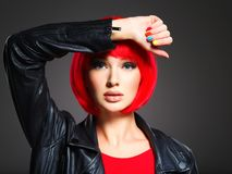 Gorgeous fashion woman with red hair and black jacket Royalty Free Stock Image