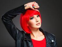 Gorgeous fashion woman with red hair and black jacket Royalty Free Stock Photography