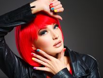 Gorgeous fashion woman with red hair and black jacket Royalty Free Stock Images