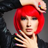 Gorgeous fashion woman with red hair and black jacket Stock Photography