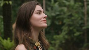 Gorgeous fashion woman walking along tropical jungle garden stock video footage