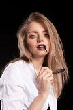 Gorgeous fashionable blonde model with suspenders and white shir Stock Photos