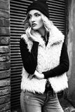 Gorgeous fashionable sexy young blonde woman street portraits. Black and white Stock Image