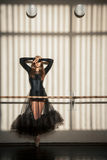 Gorgeous female ballet dancer standing at the wall Royalty Free Stock Images