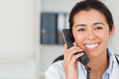 Gorgeous female doctor on the phone and posing Royalty Free Stock Images