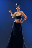 Gorgeous female fashion model wearing top and long black skirt Stock Photo