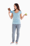 Gorgeous female holding a chocolate bar Stock Photos