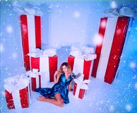 Beauty fashion woman Christmas background new year tree. Vogue style sexy girl. Gorgeous female in luxury fur at Xmas. Gorgeous female in luxury fur at Xmas Royalty Free Stock Images